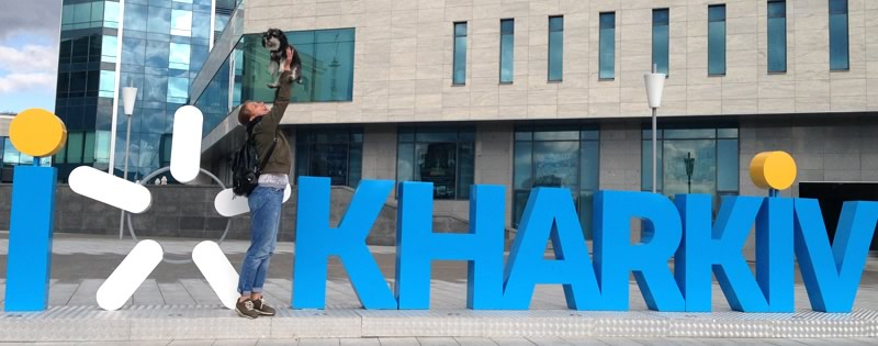 willie with a new friend in front of the Kharkiv sign